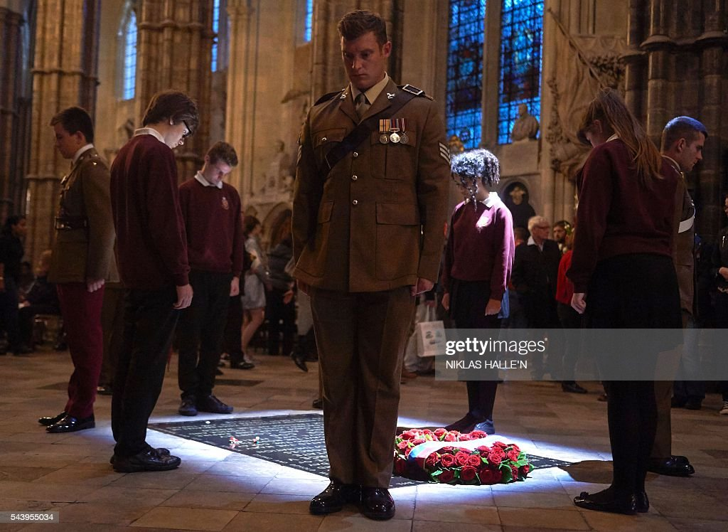 Five civilians and five members of the military undertake a Vigil at Grave of the Unknown Warrior after the Service on the Eve of the Centenary of the Battle of the Somme at Westminster Abbey in London on June 30, 2016. Westminster Abbey is holding a Service on the Eve of the Centenary on June 30 2016, and an Overnight Vigil the first time the Abbey has been open all night for a vigil since peace vigils for the Cuban Missile Crisis over fifty years ago. The Abbey service and vigil are part of a programme of centenary events which includes vigils in Scotland, Wales and Northern Ireland, and at Thiepval, Northern France. / AFP / POOL / Niklas HALLE'N