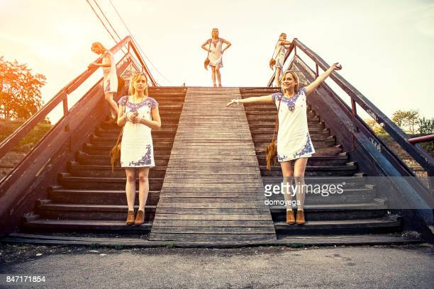 five copies of the same girl on the wooden bridge - repetition stock pictures, royalty-free photos & images