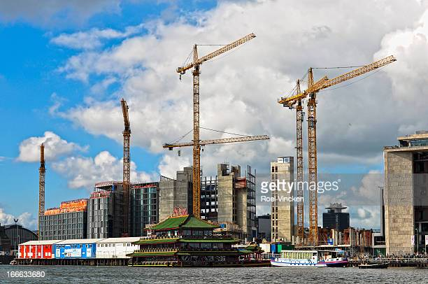 CONTENT] Five cranes working on a construction project in Amsterdam