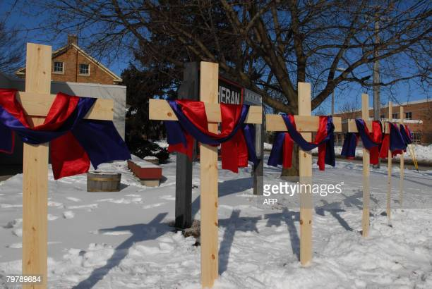 Five crosses representing five victims are seen at the campus of Northern Illinois University in DeKalb Illinois on February 15 for the victims of...