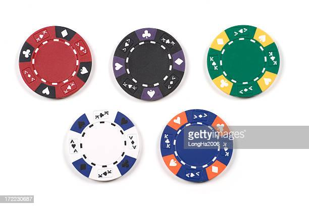 Five different colored poker chips