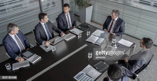 Five directors and CEO in meeting