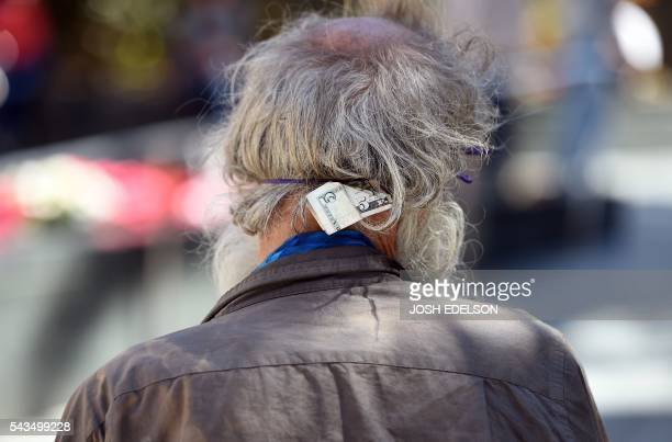A five dollar bill is seen tucked in a homeless man's headband in downtown San Francisco California on Tuesday June 2016 Homelessness is on the rise...
