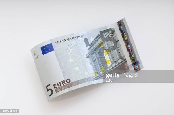 Five Euro dollar waves on the plain cream background