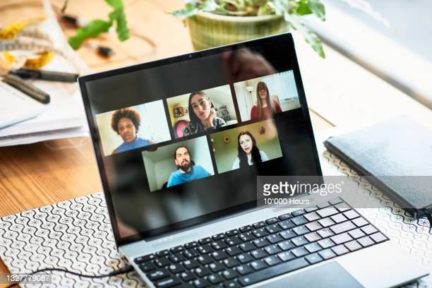 five faces on laptop screen during video conference - greater london stock pictures, royalty-free photos & images