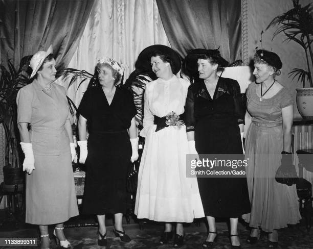 Five female Democratic Party leaders stand together during a function including from left to right United States Ambassador to Luxembourg Perle Mesta...