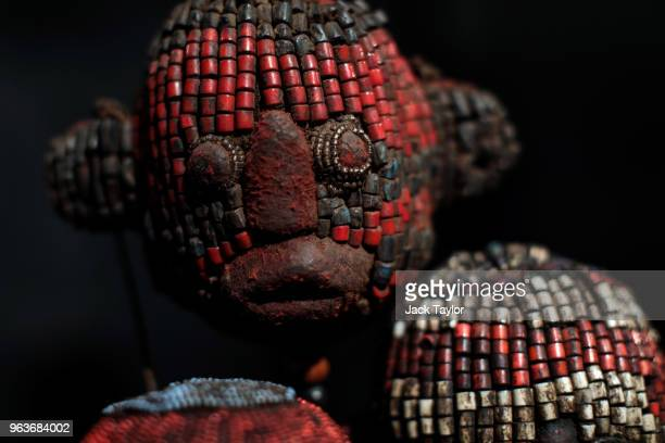Five fine beaded ceremonial heads from the Grassland people Cameroon 1930's stand during a press preview at Summers Place Auctions on May 30 2018 in...