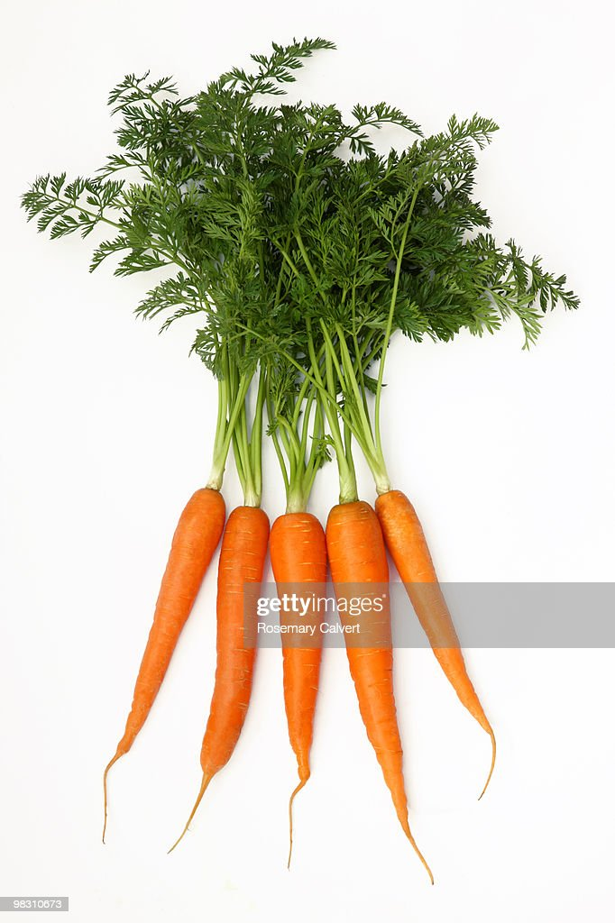 Five Fresh Organic Carrots With Green Tops Stock Photo - Getty Images