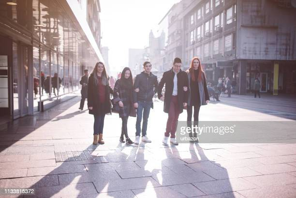 five friends going for a walk - pedestrian zone stock pictures, royalty-free photos & images