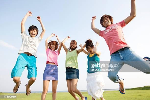 Five friends jumping