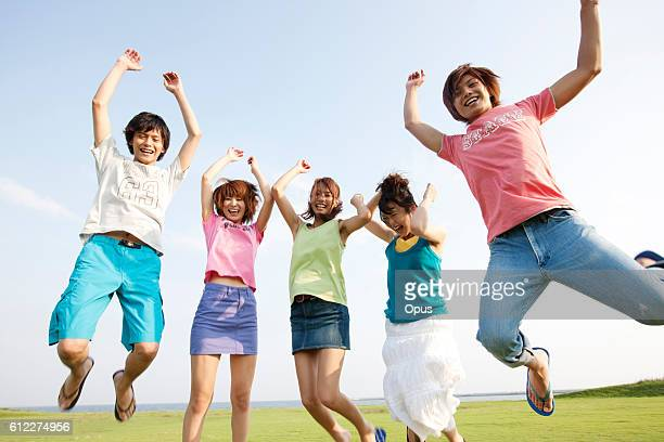Five friends jumping