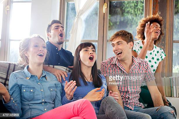 Five friends watching television