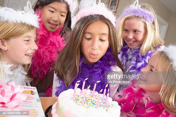 five girls (10-11 years) around birthday cake, one blowing candles - princess stock pictures, royalty-free photos & images