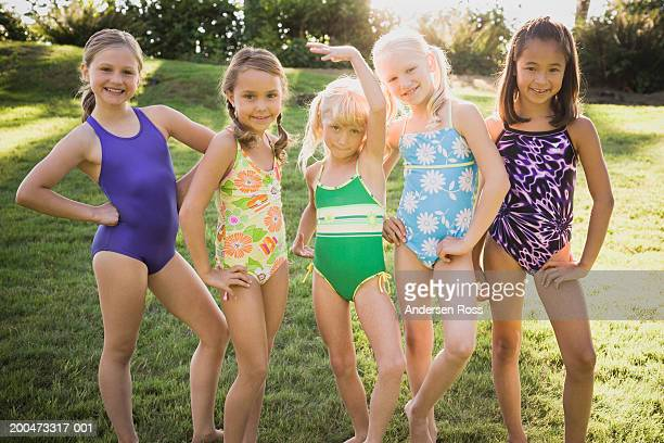 five girls (7-10) in swimsuits standing side by side, portrait - cute little asian girls stock photos and pictures