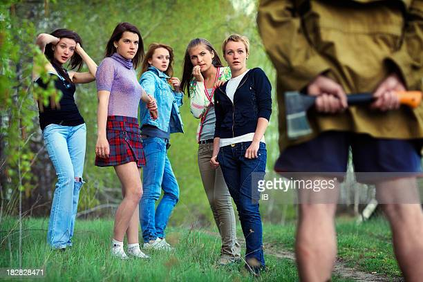 five girls saw in the woods maniac with an axe - pursuit concept stock photos and pictures