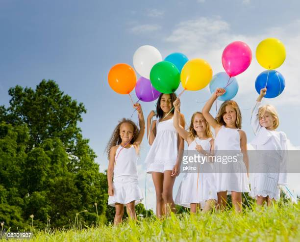 Five girls show off their multicolored balloons