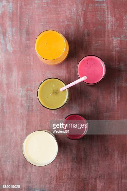 Five glasses of different smoothies