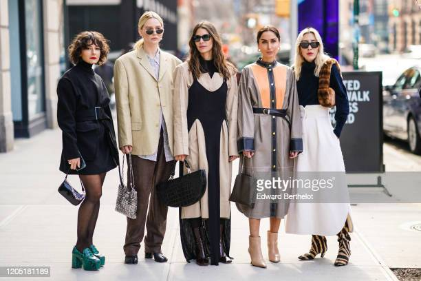 Five guests are seen: A guest wears a balck dress, a bag, green shoes ; a guest wears sunglasses, an oversized blazer jacket, a metallic bag, brown...