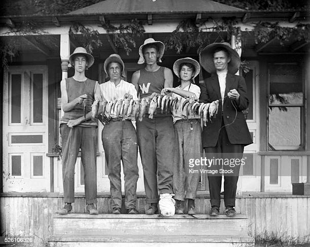 Five guys pose with their fish ca 1910