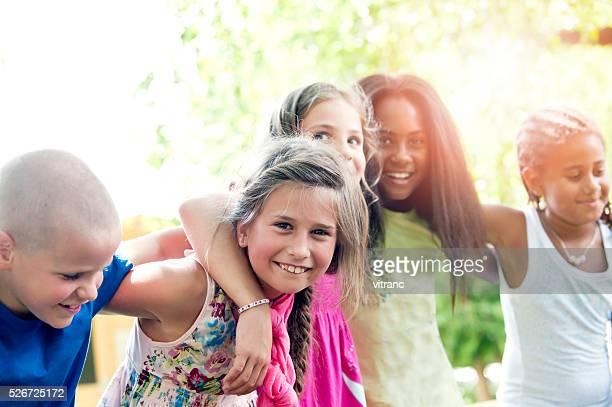 Five happy children in summer