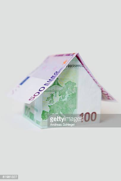 A Five Hundred Euro Banknote and a Hundred Euro Banknote folded to look like a house