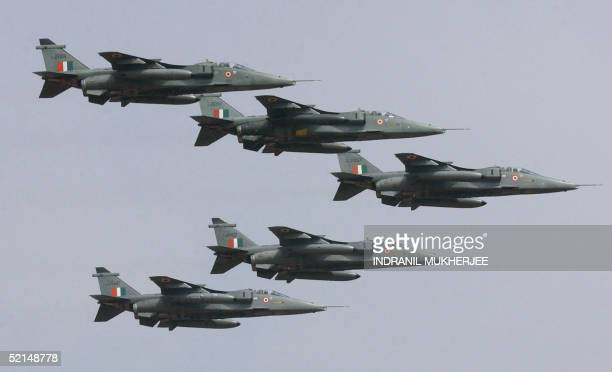 Five Jaguar aircrafts in an arrowhead formation of the Indian Air Force fly over the Yehlanka airforce base on the outskirts of Bangalore 06 February...