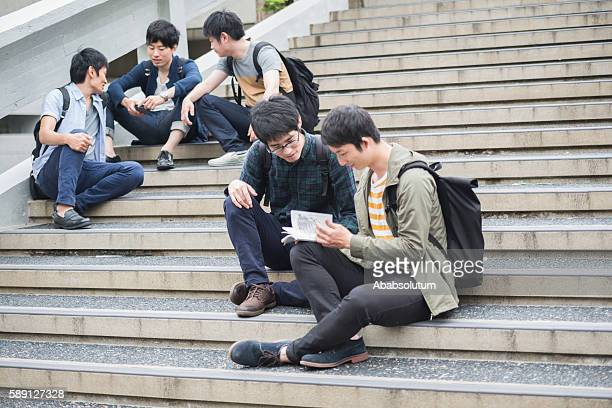 Five Japanese Students Having Fun on Staircase, Campus, Kyoto, Japan