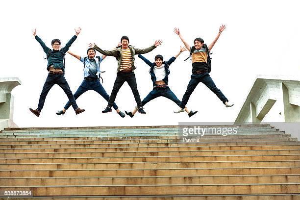 Five Japanese Students Jumping, Campus, Kyoto,Japan