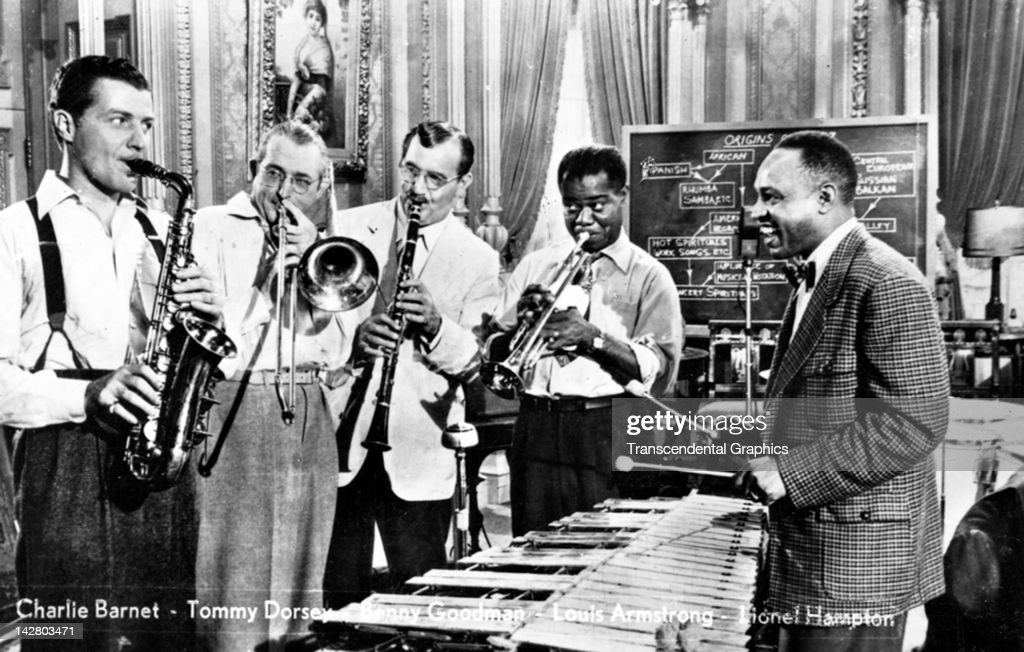 Five jazz greats perform together in this photographic postcard made circa 1950 in Berlin, Germany. They are (L-R) Charlie Barnet, Tommy Dorsey, Benny Goodman, Louis Armstrong, and Lionel Hampton.