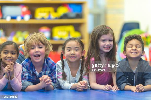 five kids smiling for a photo - community centre stock pictures, royalty-free photos & images