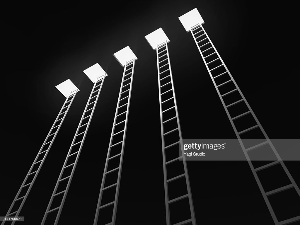 Five ladders leading to the exit, black background : ストックフォト