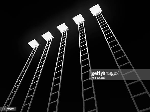 five ladders leading to the exit, black background - five objects stock pictures, royalty-free photos & images
