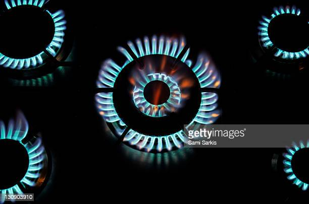 Five lit blue gas rings  (high angle view)