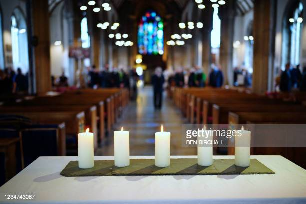 Five lit candles are seen on the altar after a civic service at Minister Church Of St Andrew in the Keyham area of Plymouth, southwest England, on...