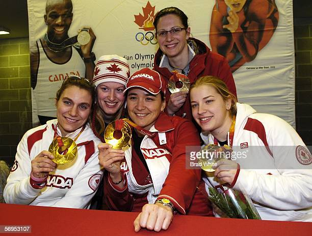 Five members of the Canadian Womens hockey team Cheryl Pounder Sami Jo Small Vicky Sunohara Cherie Piper and Gillian Ferrari demonstrate their Gold...