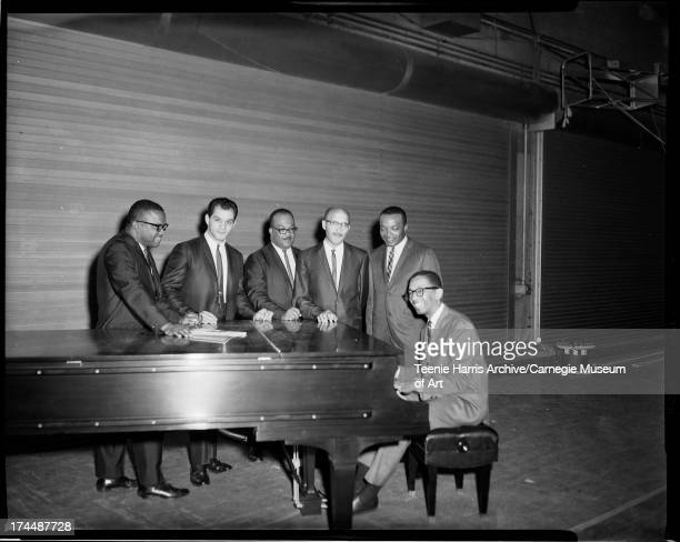 Five men including Nate Harper and Walt Harper gathered around piano played by Billy Taylor at Pittsburgh Jazz Festival Civic Arena Pittsburgh...