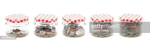Five money jars in a row