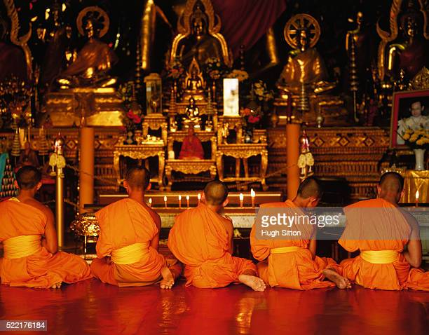 five monks praying in front of shrine, thailand - hugh sitton stock pictures, royalty-free photos & images