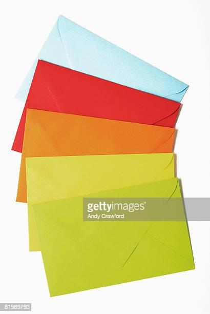 Five multi-coloured envelopes