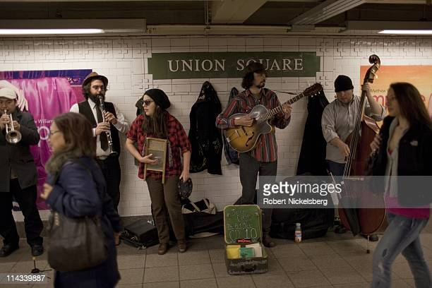 Five musicians play a song at the Union Square or 14th Street subway station March 28, 2011 in New York. In 2009, the New York City Subway delivered...
