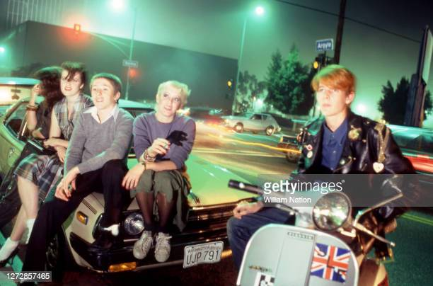 Five new wave/punk rockers hang out and smoke on the corner of Argyle and Selma circa December, 1981 in Los Angeles, California.