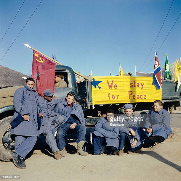 Five of the 21 American soldiers who refused to return to America at the end of the Korean War The sign on the truck reads 'We Stay for Peace' They...