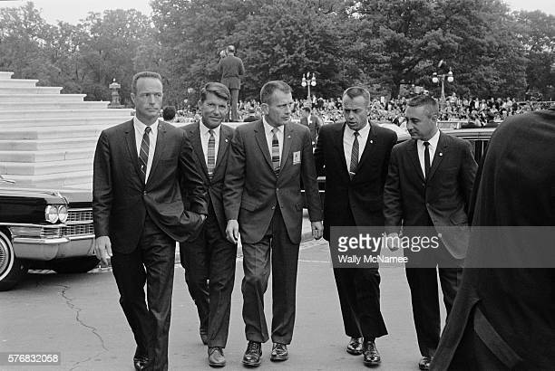 Five of the original seven Mercury astronauts walk across the Capitol Plaza during a celebratory visit to Washington DC From left to right Scott...