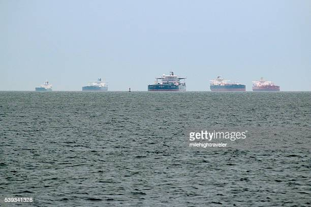 Five oil tanker ships in a row anchored Delaware Bay