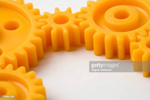 Five orange cogs interlocked