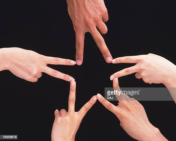 Five people making star with hands