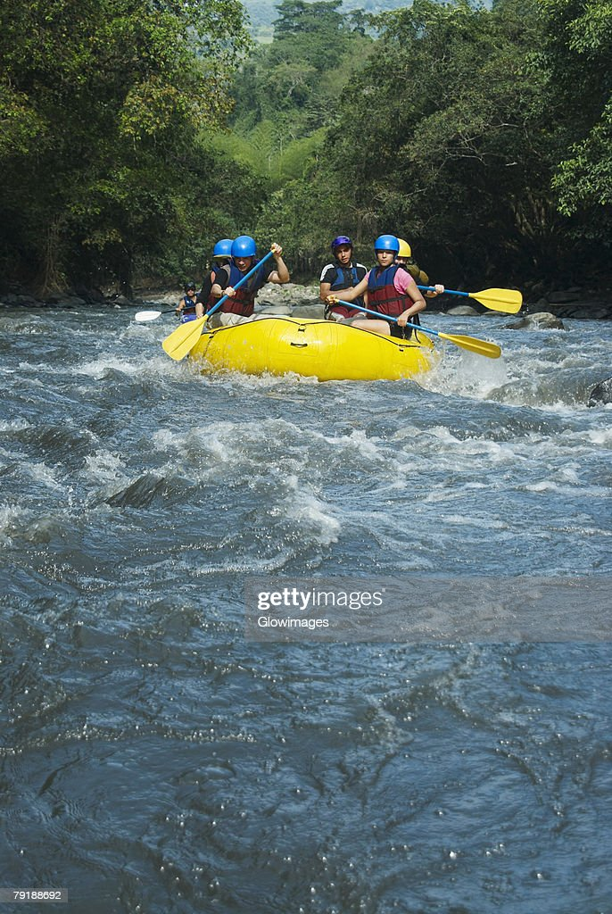 Five people rafting in a river : Foto de stock