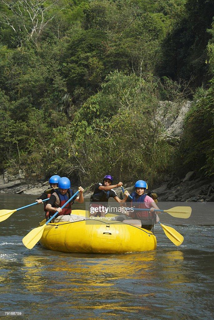 Five people rafting in a river : Foto de stock