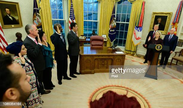 Five people take the oath of citizenship from United States Secretary of Homeland Security Kirstjen Nielsen during a ceremony hosted by US President...