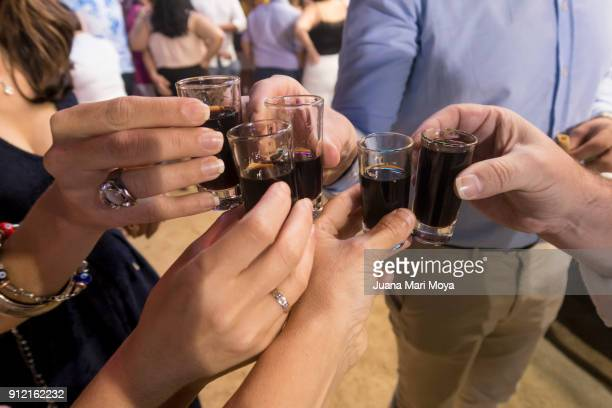 Five people toasting with wine glasses